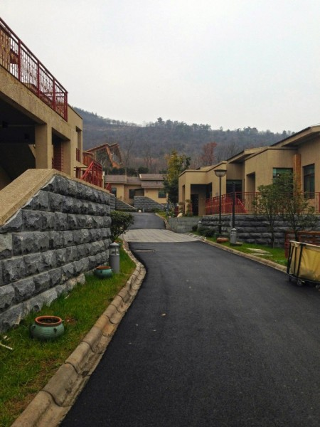 """Rows of """"townhouses"""", and villas with private hotspring tubs, away from the main hotel compound."""